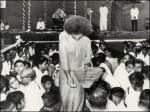 Sathya Sai Baba Distributing Vibuthi